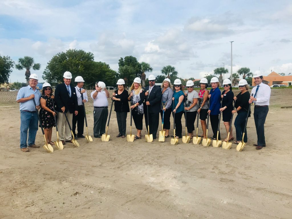 team of people in hard hats about to break ground on cape coral animal shelter new building